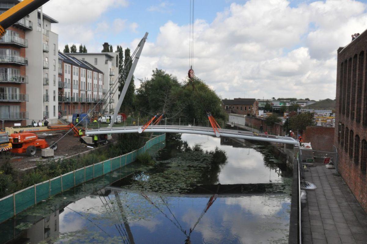 Hungate's modern footbridge, astride the River Foss near Foss Harbour seen here under construction