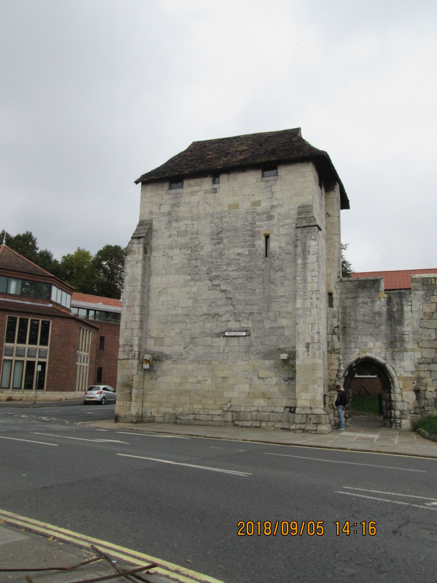 The Postern Gate at the wall's end. The 'tower' in the street name is Clifford's  Tower 200 yards to your left on the motte or hill across the way from the more modern castle doorway (where you find the cell Dick Turpin was held before his execution
