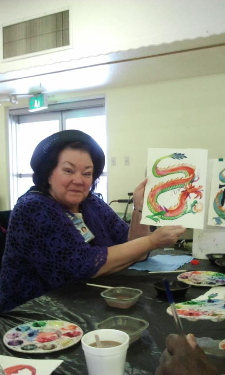 Me posing with a painting in one of my elderly classes.