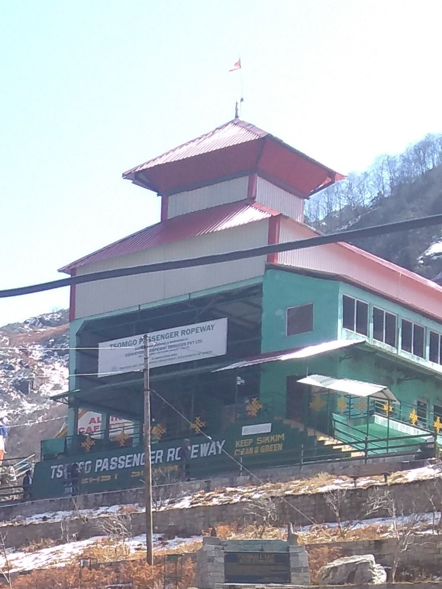 Travelers need to climb the stairs to reach the ticket counter of the ropeway