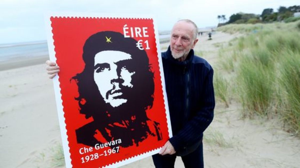 Irish artist Jim Fitzpatrick creator of the iconic image of Che with large copy of Ireland's stamp commemorating the Argentinian-Irish revolutionary