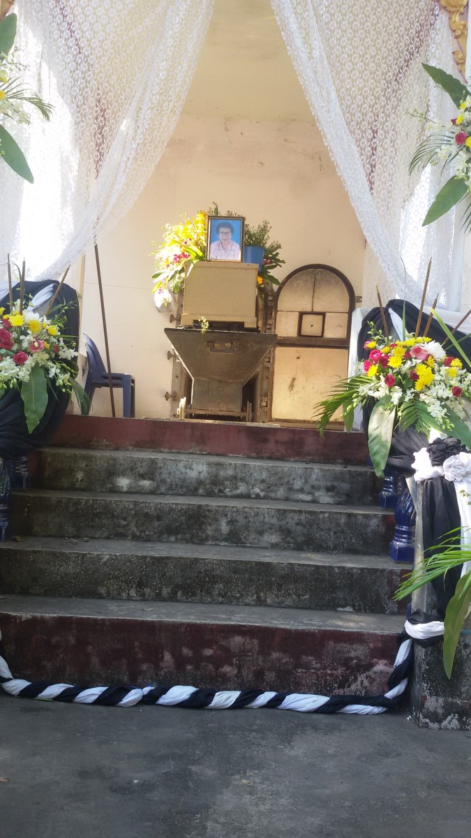 Coffin of deceased in front of the furnace of the Dongsakol Temple crematorium