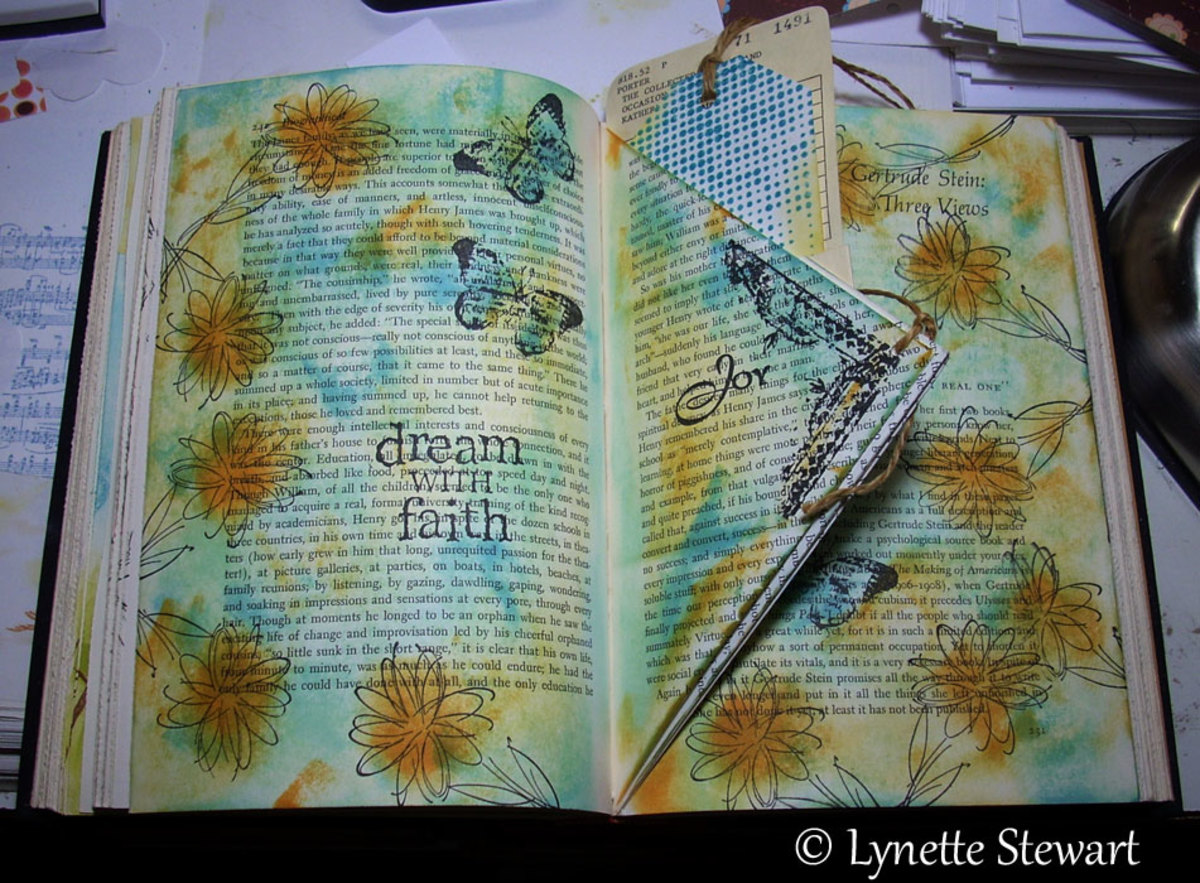 Creating in your altered book means that you are not limited in how you create your layouts, Here the artist uses creative folds in her book