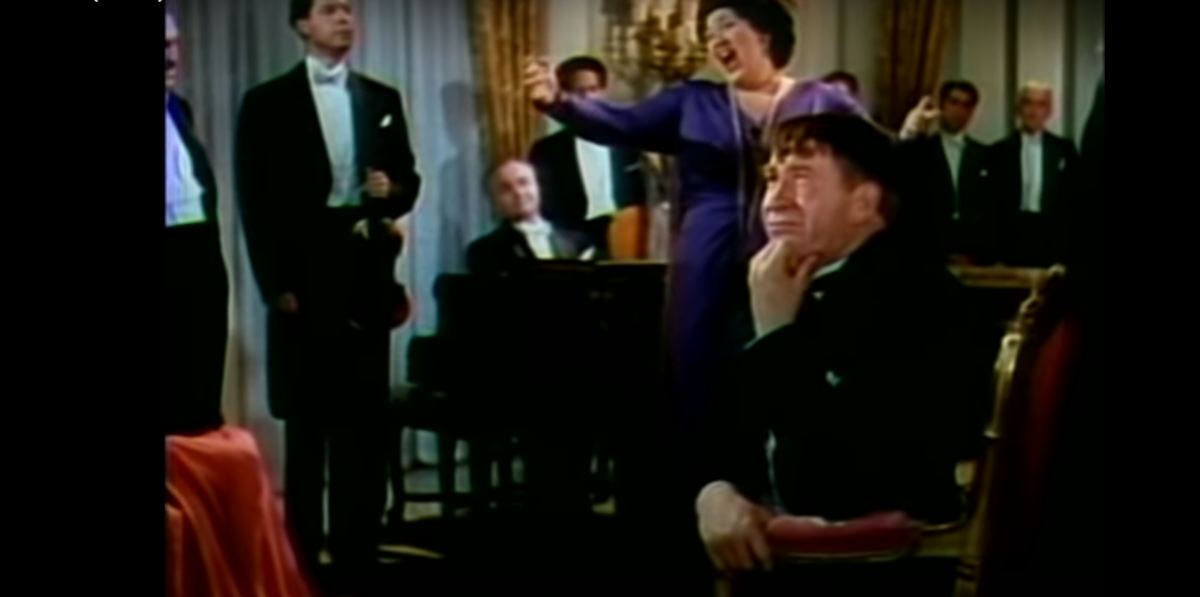 The music grates on Pinky Jimson (in the foreground).  Played by Chill Wills