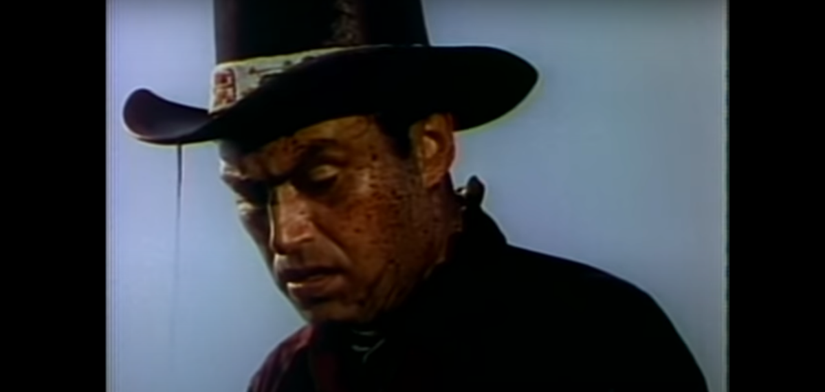 Jim Redbird is drenched in oil.  Played by Pedro Armendariz