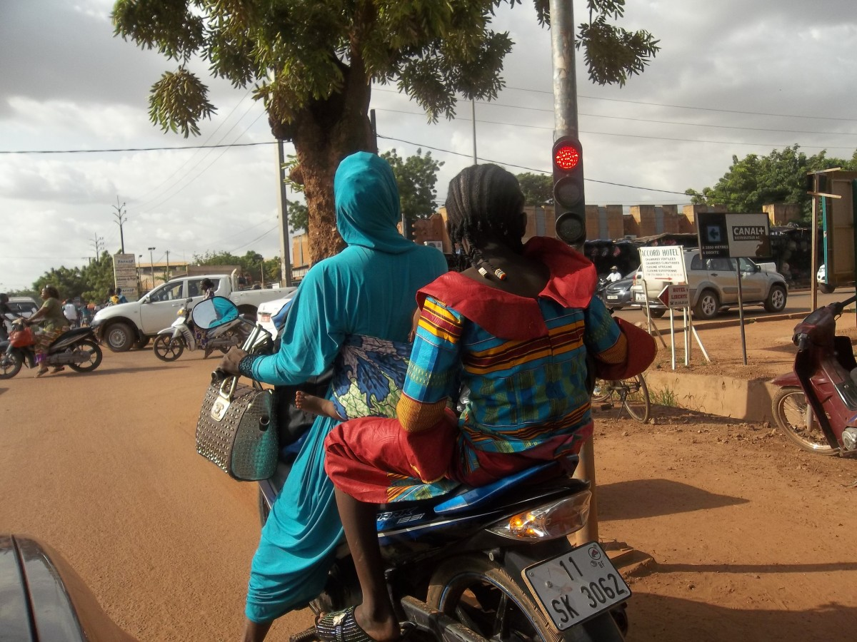 Women are very comfortable riding motorbikes in Ouagadougou