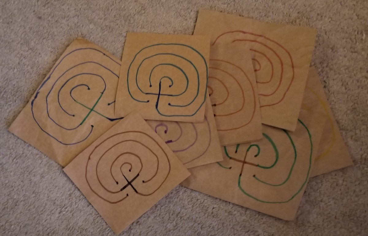 Make a bunch of finger labyrinths to walk and write on from journal prompts, then bind all of the ones you created for one project together as a record of your creative process for that project.  They can serve as companions to your writing journal.