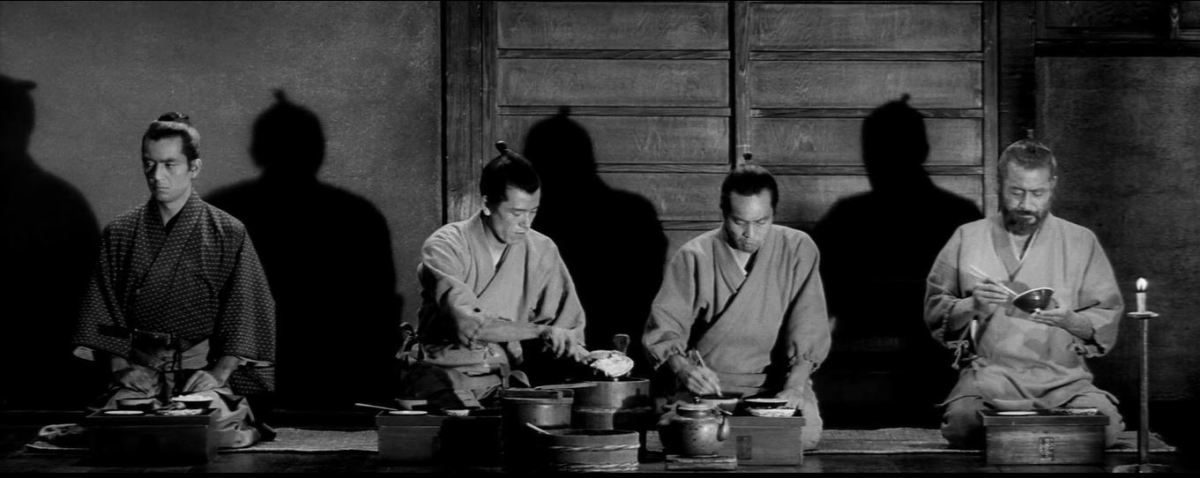 Sullen Yasumoto and his colleagues at the dining place. Red Beard is at the farthest right.