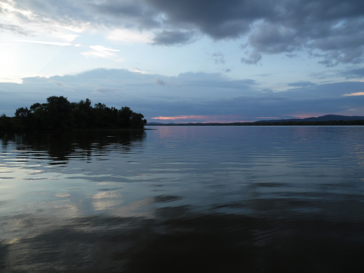 Storm clouds mix up a perfectly good sunset at the lake.