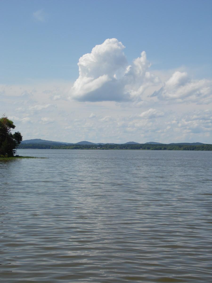 Big, puffy cloud hangs lazily over Weiss Lake.