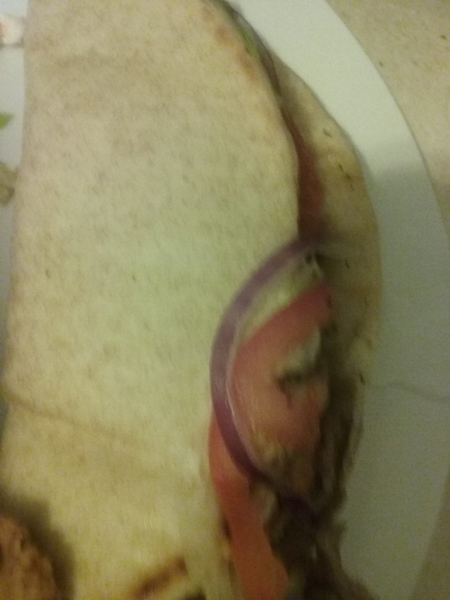Impressively traditional Greek gyro sandwich, served at Arby's fast food restaurant.