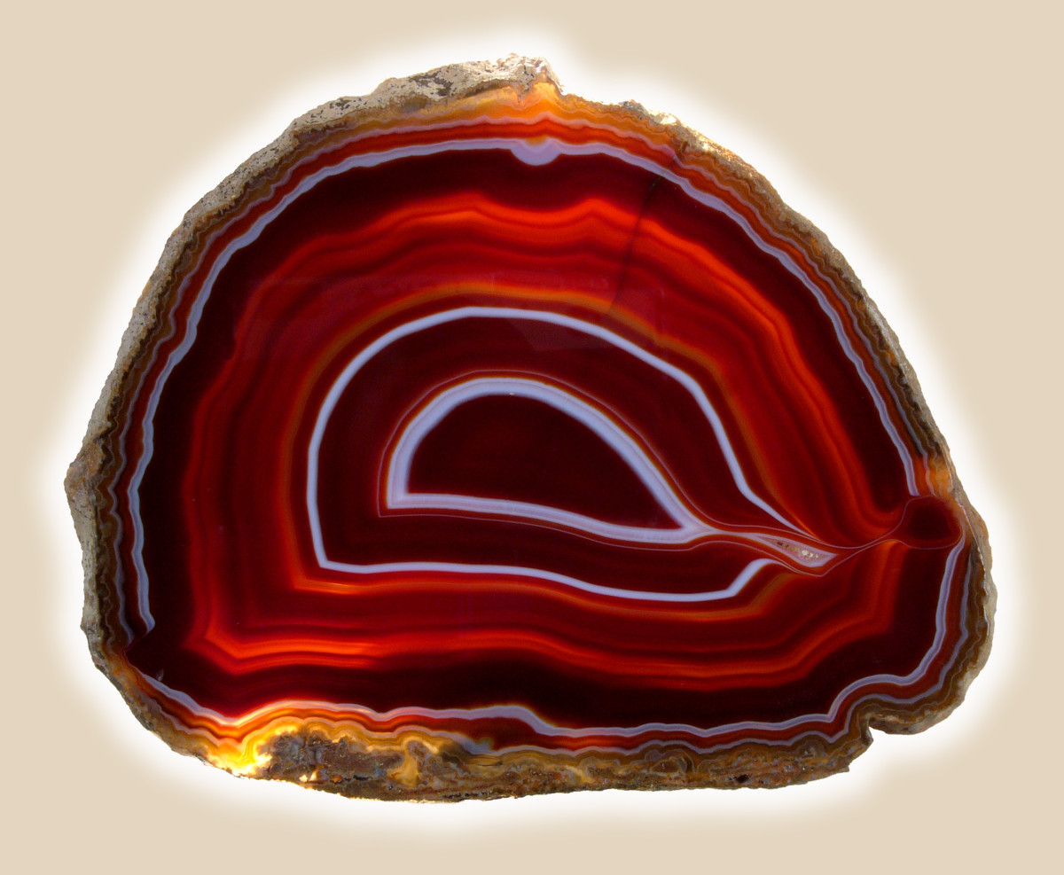 This may or may not be Nanhong Agate.  The materials and sculptures are so rare, that it's hard to find accurate pictures.  However, Nanhong Agate sculptures look similar to this type of agate.