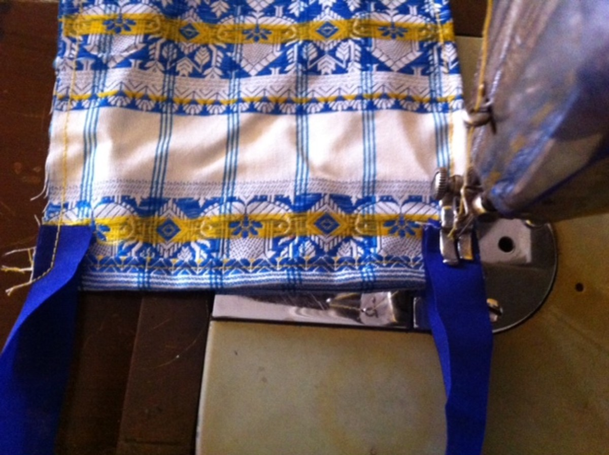 Sew ribbons on the inner side of both side the edges