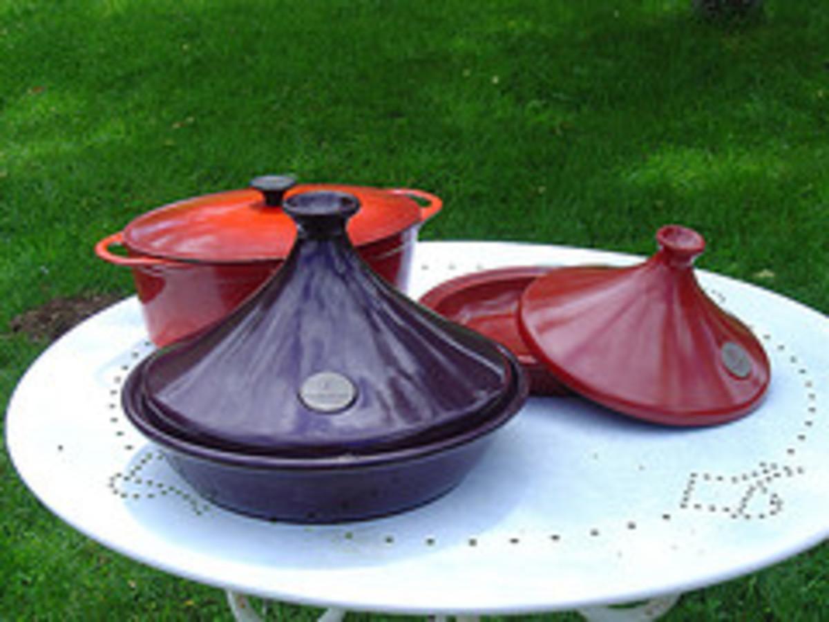 Glazed  Emile Henry Flame Top Tajine pots and enamelled Le Creuset style Casserole dish