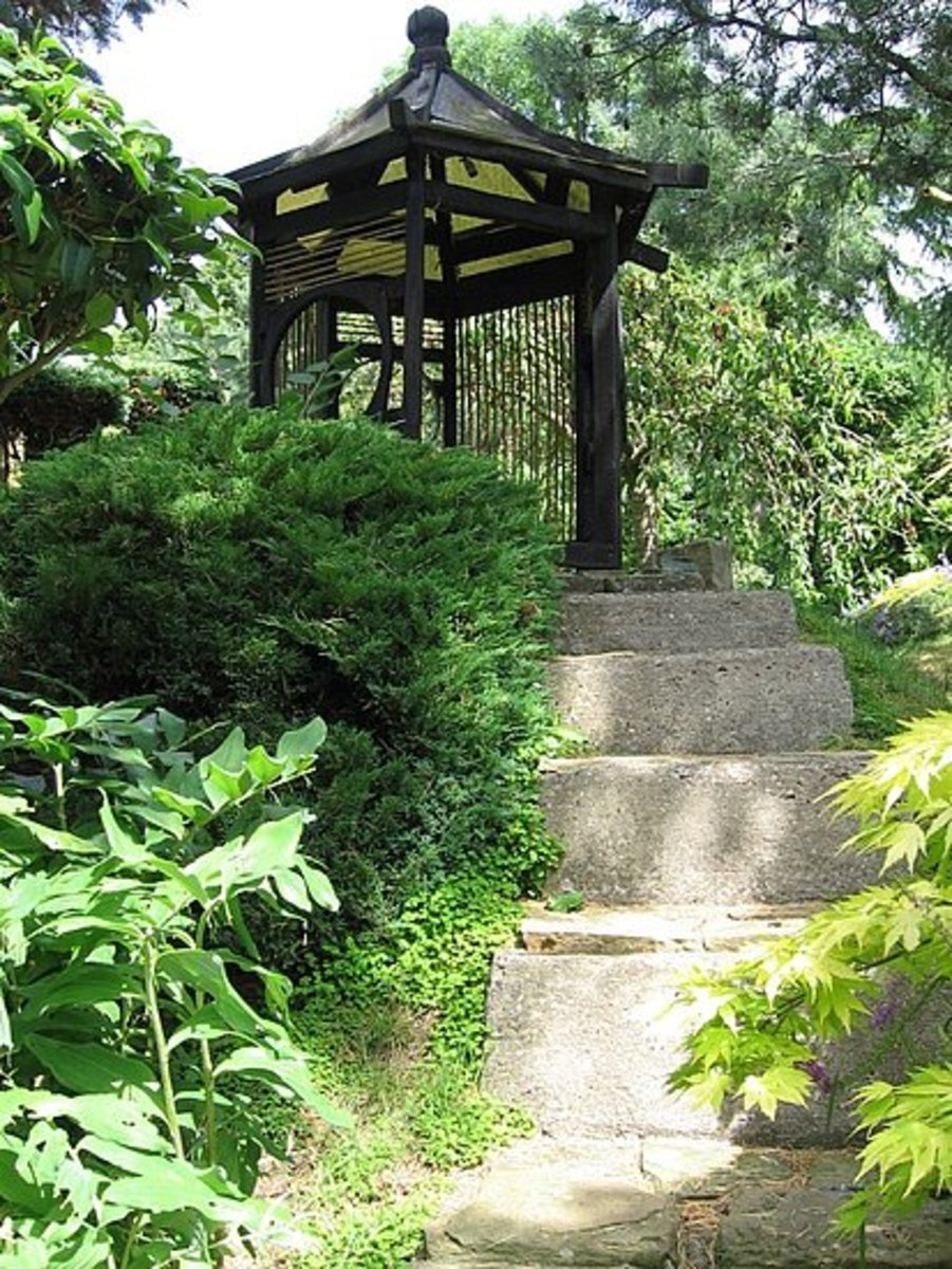Your inner residential landscape designer has to be loving this. Architectural elements can work wonders in landscapes. This pagoda is a little sanctuary in a lush backyard landscape design. Also try archways or small bridges with wood hand rails.