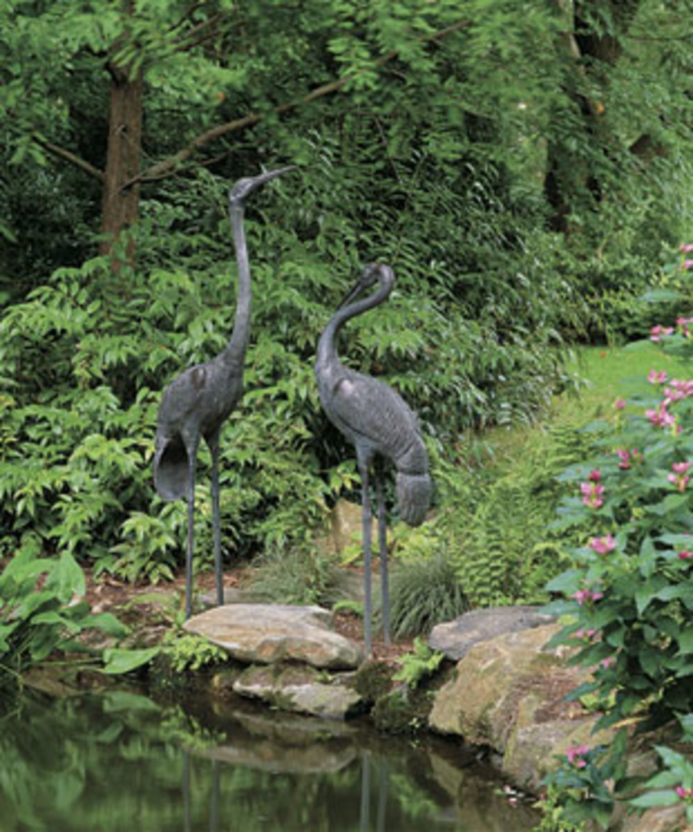 This is an example of toning it down a notch with traditional backyard ornaments. Instead of having many of them there are only two, and instead of using the bright pink flamingo ornaments this homeowner uses a more subtle color.