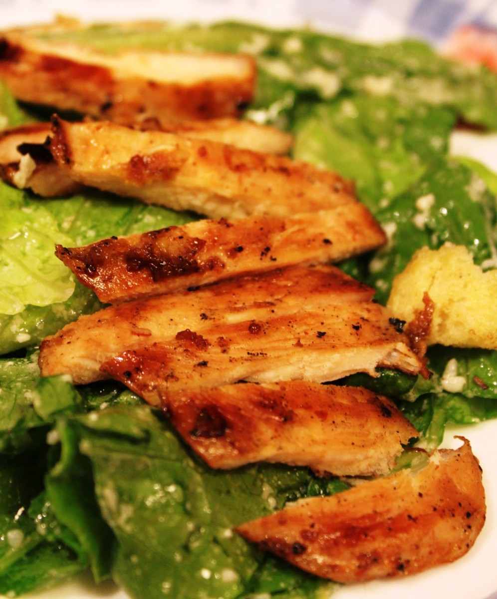 Asian-style grilled chicken over Caesar Salad.
