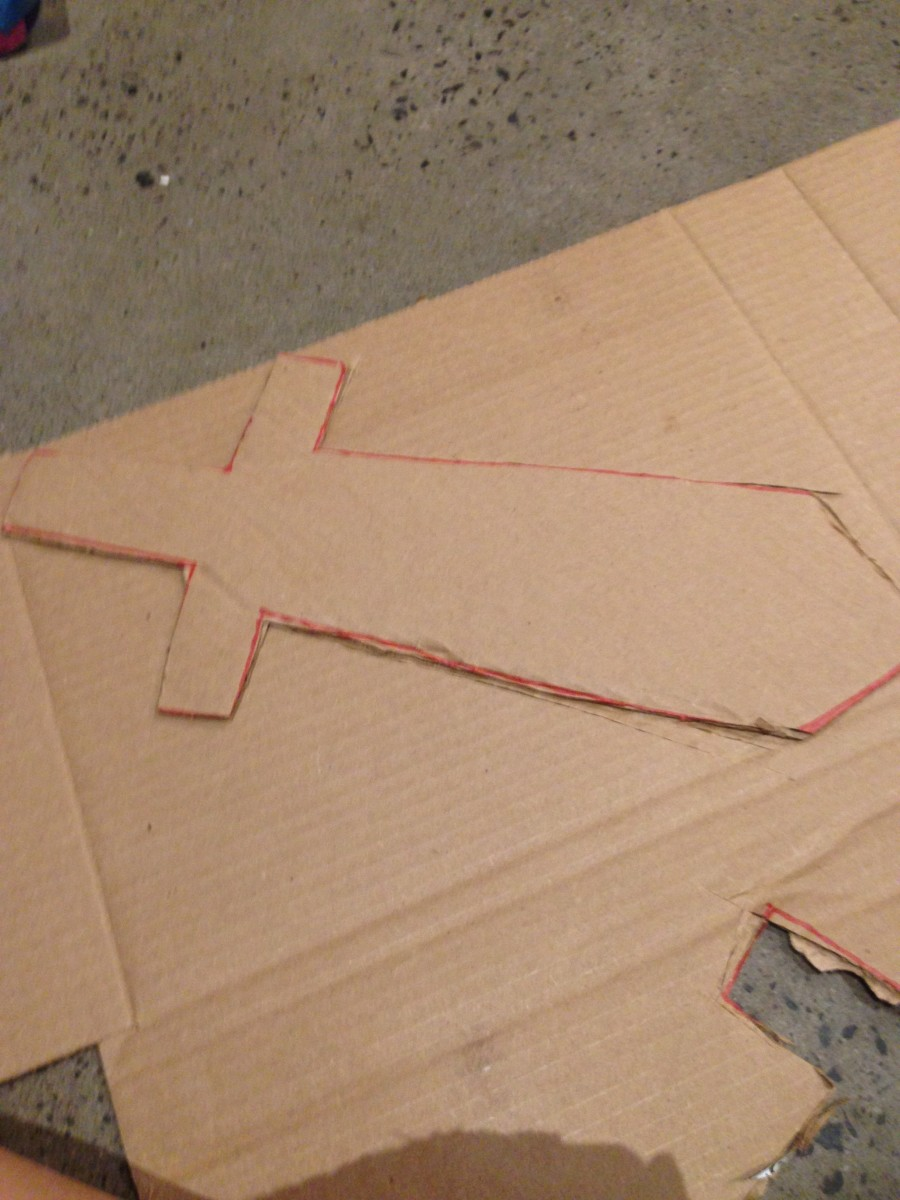 Cut out two cardboard pieces with the corrugation going in different directions to make piece stronger.