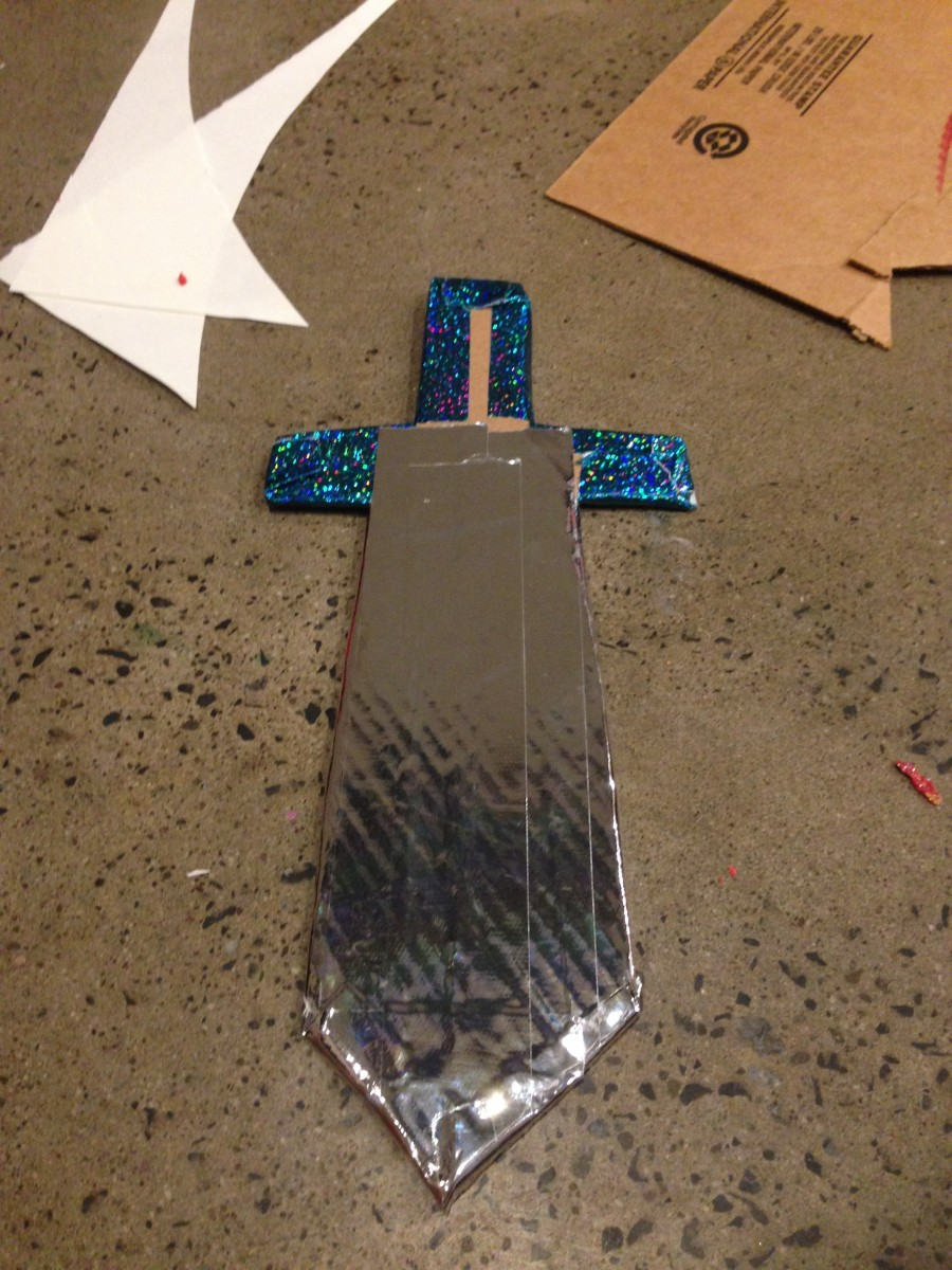 Add decorative tape to cardboard.