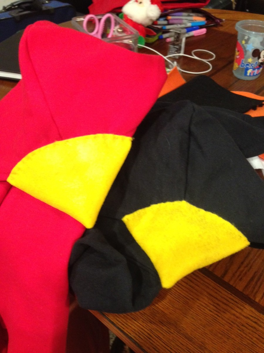 I sewed the top portion of the beak cones to the top of the hood, and the bottom portion underneath the hood.  This made the beaks more firm.