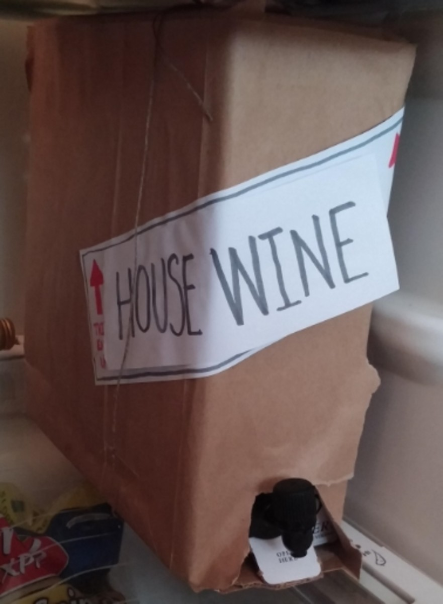 "Wrap a box of wine in brown lunch bag paper, slap a ""This End Up"" label on it and write House Wine.  Then tie some twine on so it looks like a moving box."