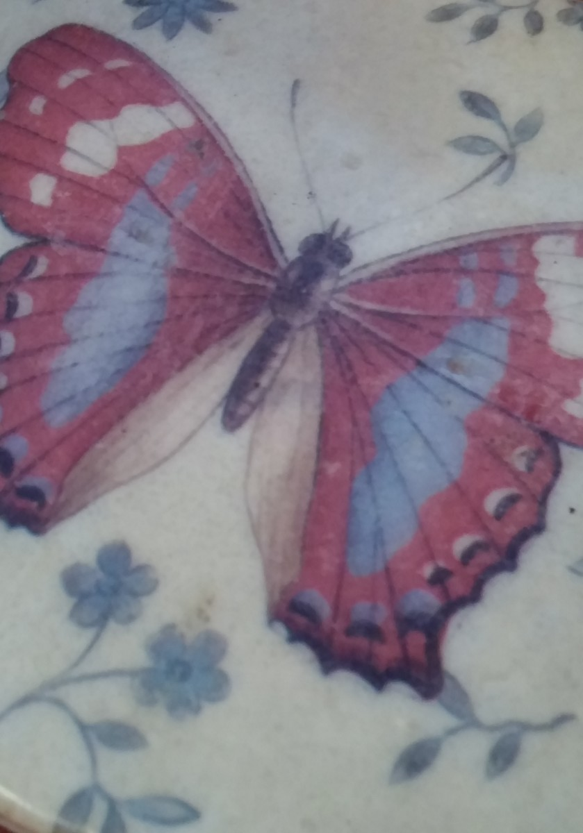 I purchased a set of beautiful butterfly coasters at the dollar store.  Wrap them in colored cellophane and add a bow.