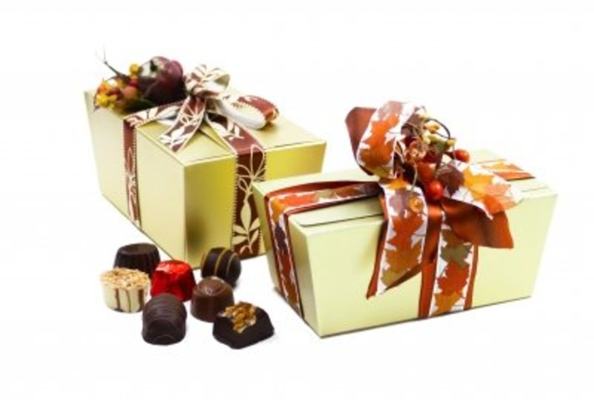 """Gold boxes and ribbon from Dollar Store.  Fill with home-made chocolates or cookies.  I include a """"use by date"""" on the tag or """"open now"""" to keep fresh."""
