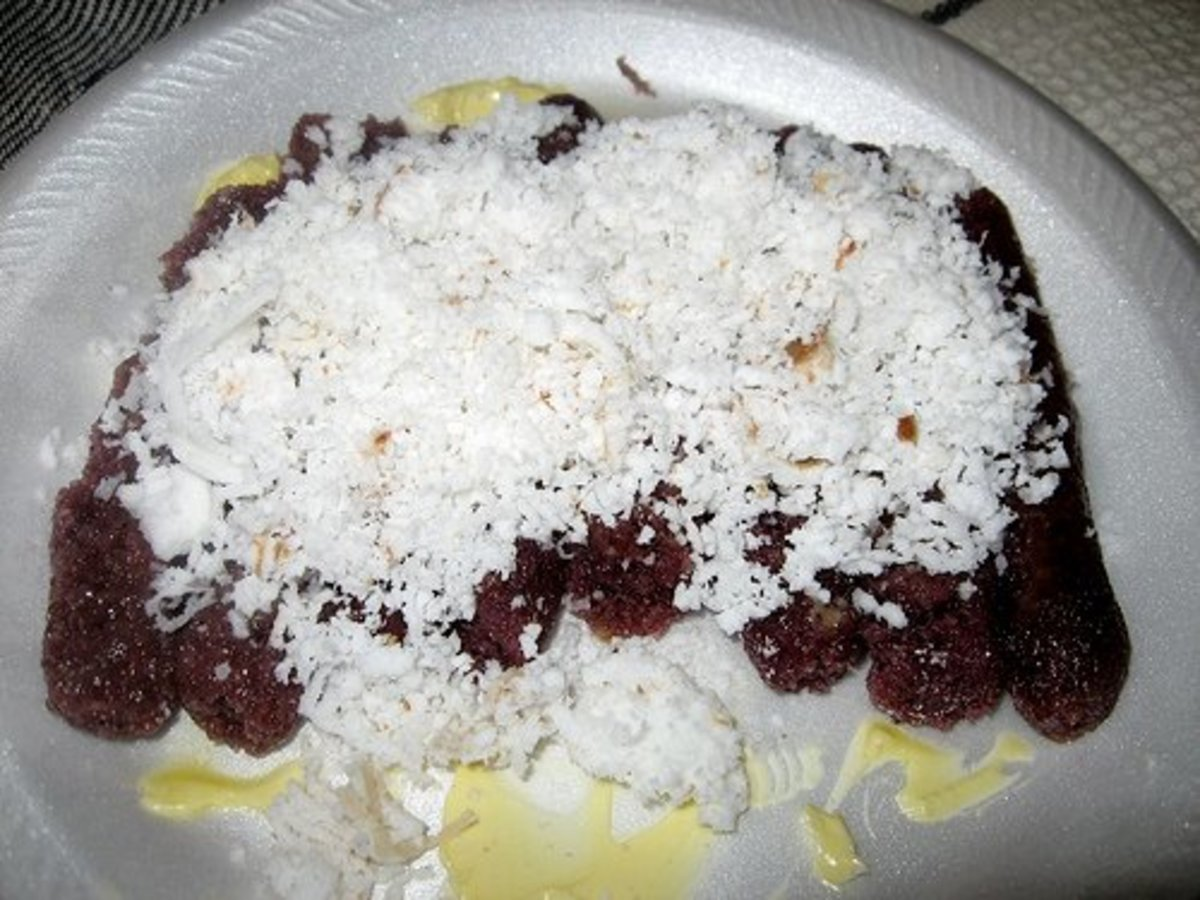 Puto Bumbong Served with Freshly Grated Coconut and Butter (Photo courtesy by arnold - inuyaki from Flickr.com)