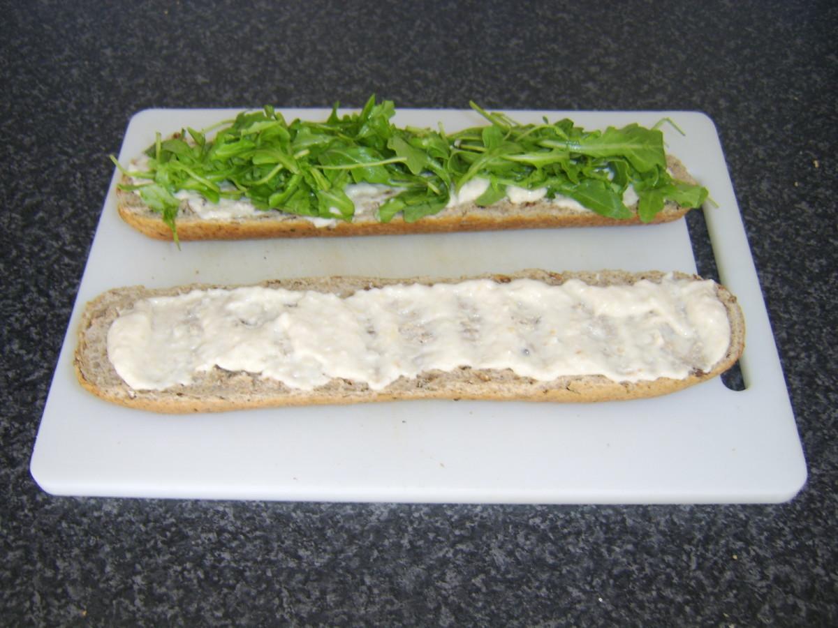 Horseradish Sauce Spread on Bread and Rocket Added