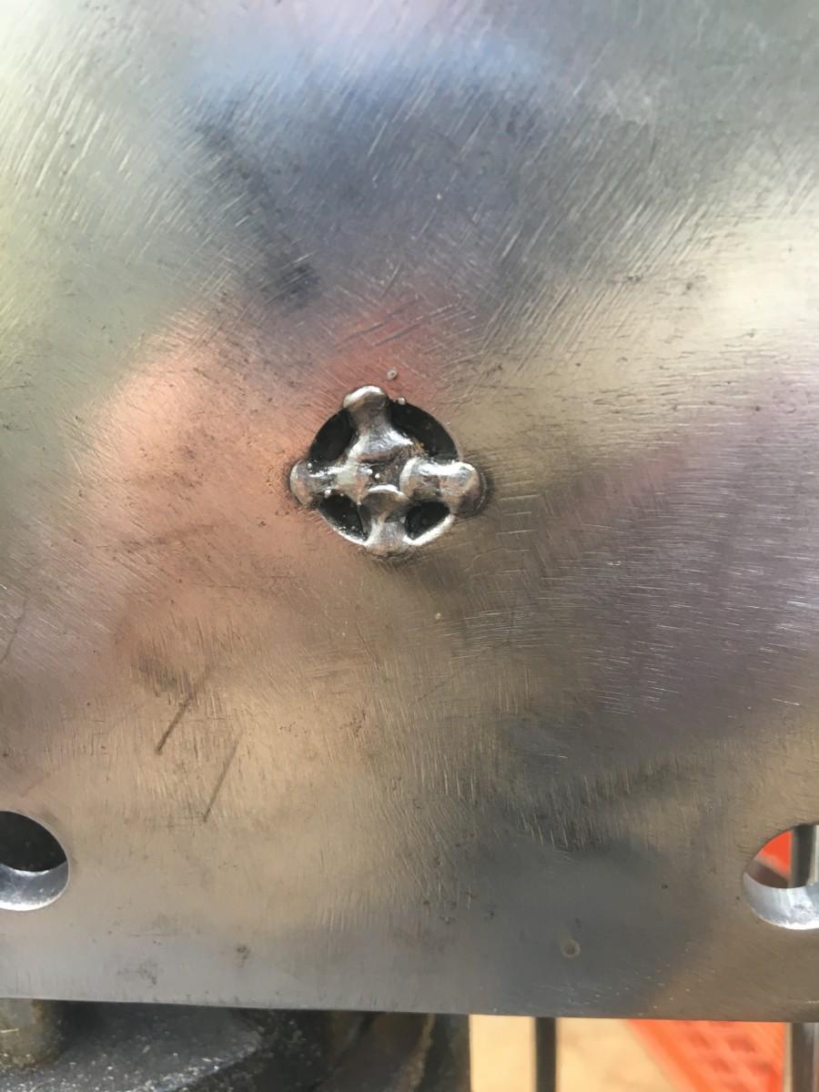 Rod tack welded at bottom of sculpture base