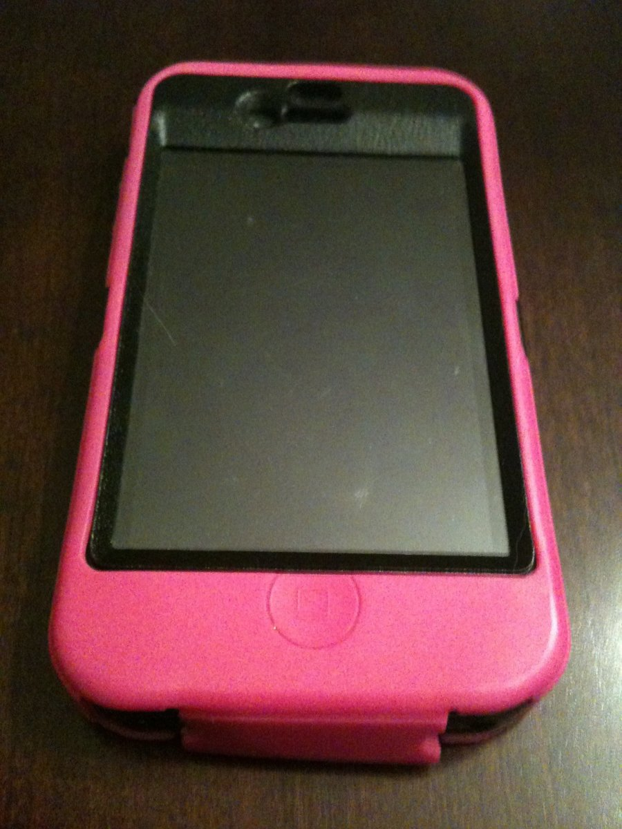 The OtterBox Defender series case fully assembled on an iPhone 4.