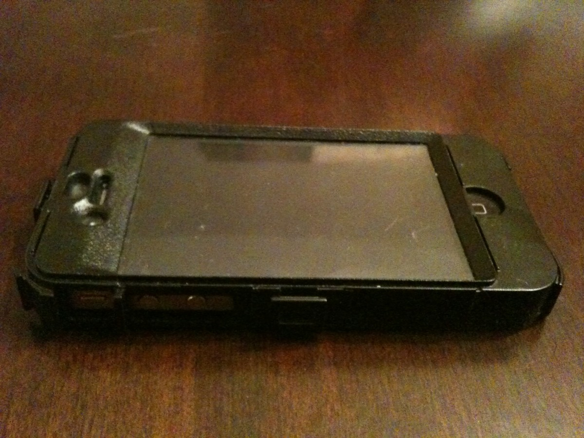 The iPhone 4 with the front and back part of the OtterBox Defender series hard plastic shell assembled.