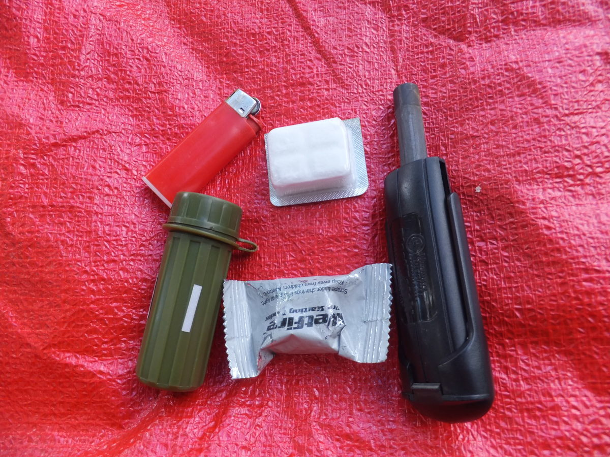 Carry a few methods of starting a fire and a few fire starters.  Here are matches, a lighter, and a UST blast match.