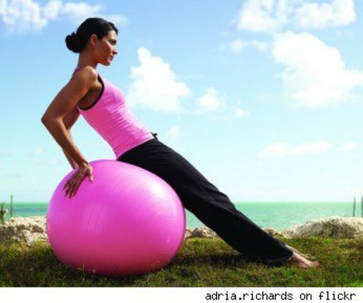 Beautiful Girl in Bright Pink with Bright Pink Balance Ball