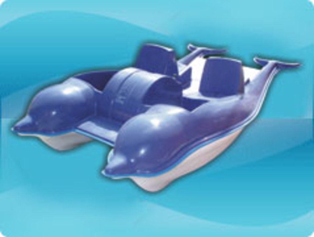 cute pedal boat in the shape of two dolphines in blue and white