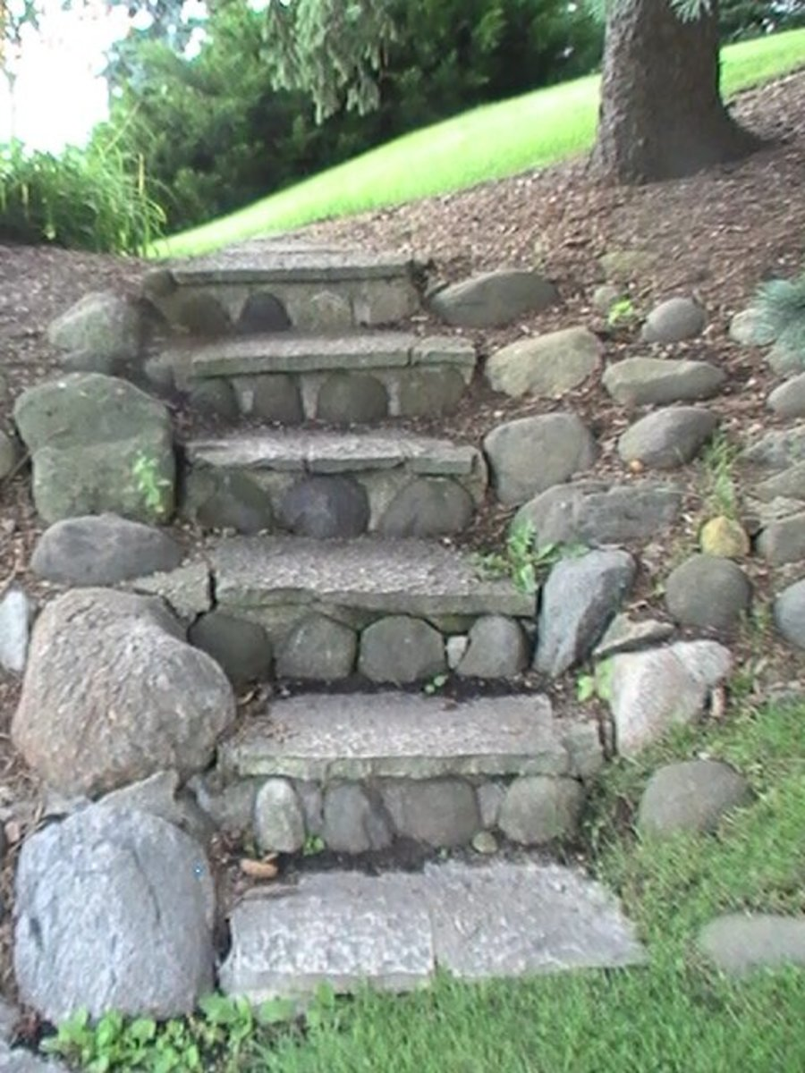 Geneva Lake Pathway - rough round stone staircase with boulders on the edge -five steps