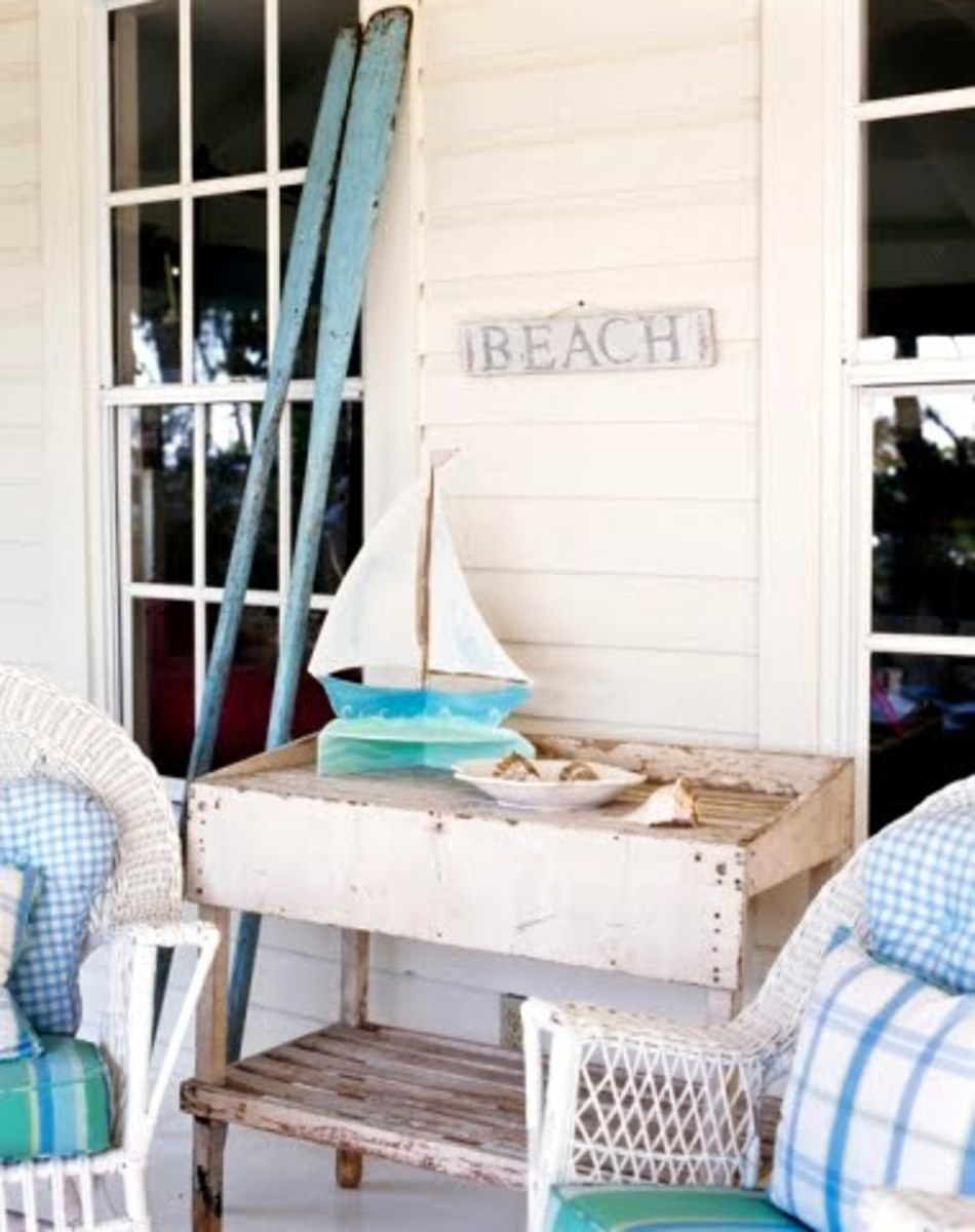 Notice the Casual finds this home owner has found. Rustic signs, a painted old table, simple fabrics.