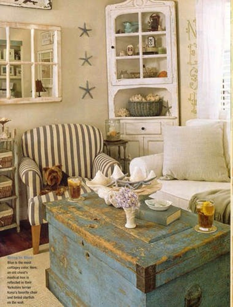 The antiqued coffee table is perfect for this french country look.