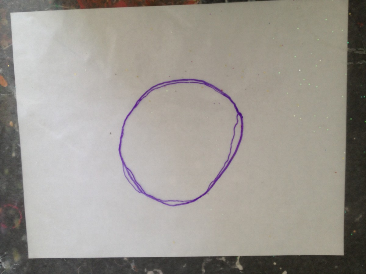 1. On wax paper, trace an outline of the Saturn yarn ball's middle section.