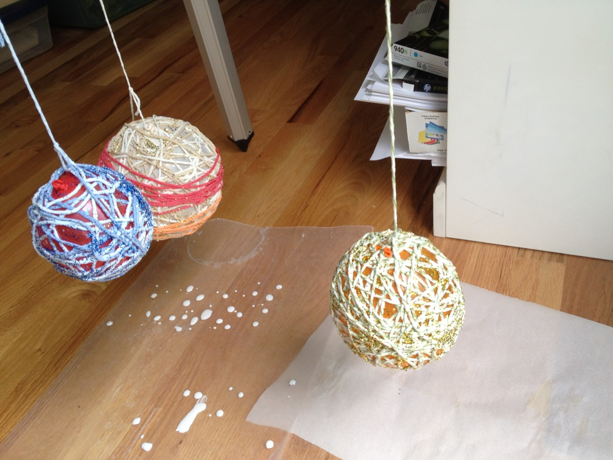 Hang yarn balls over wax paper or newspaper to dry for 24 hours.