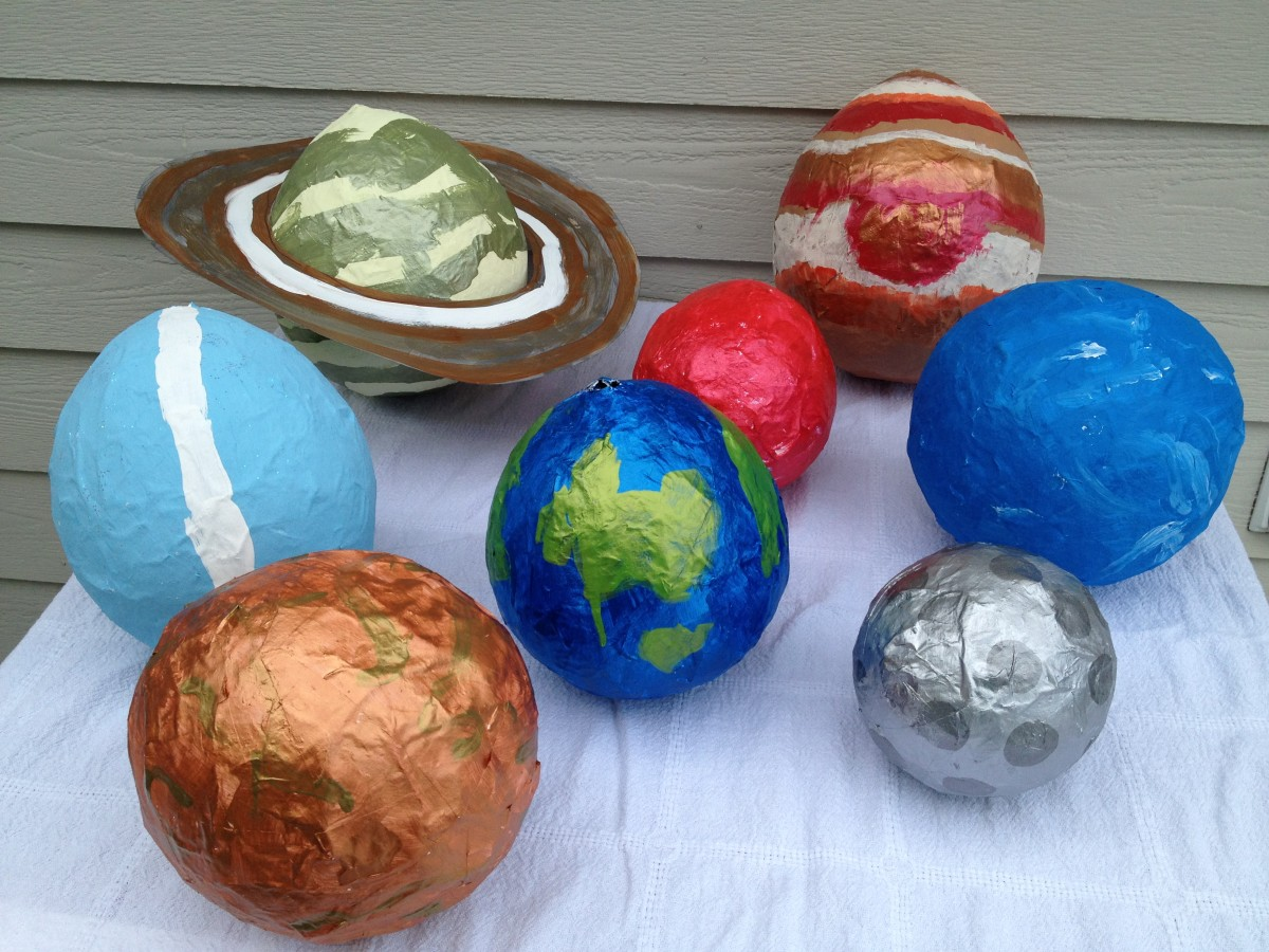 Paint swirls, strips, circles, and rings to complete your planets.