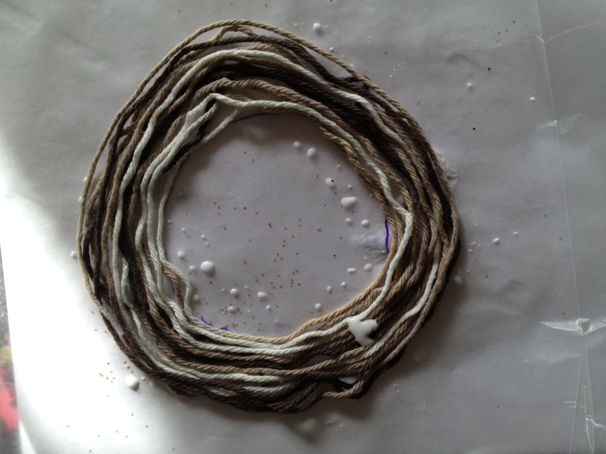 3. Add a top layer of yarn to resemble striped rings.  I used multi-colored yarn - dark brown, light brown and white.