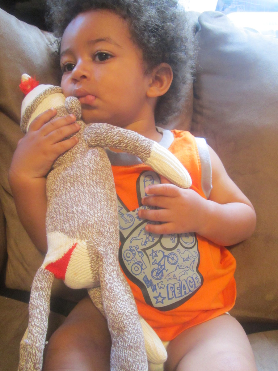 My son, Julian, with one of the many sock monkeys my great grandmother made.