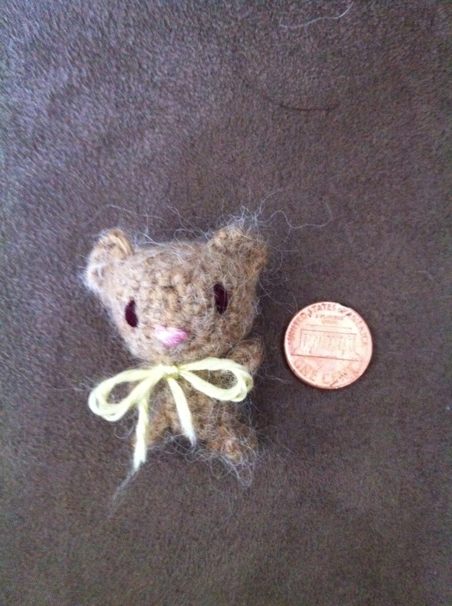 Small crocheted characters or patches can also make great pins.
