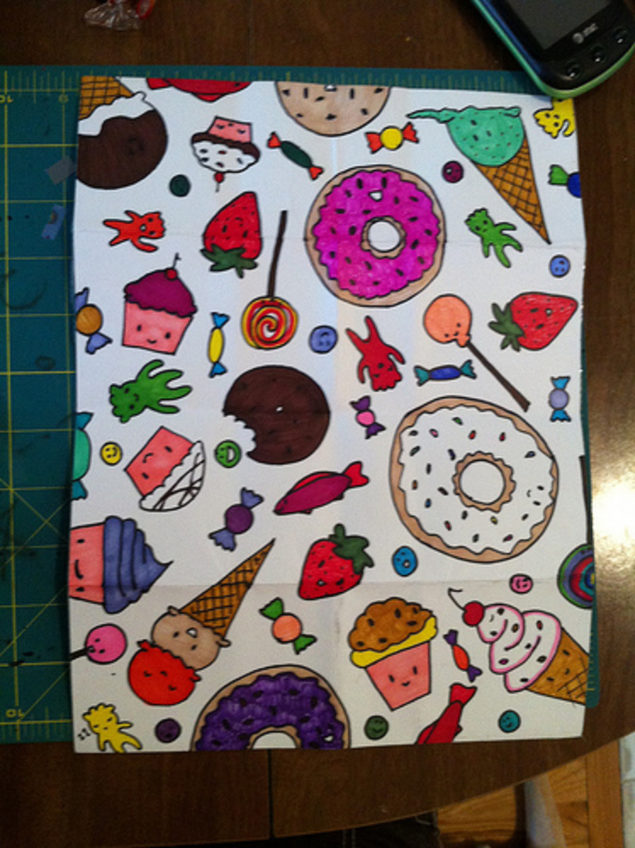 I drew the sweets design on printer paper and my sister coloured it in with markers.