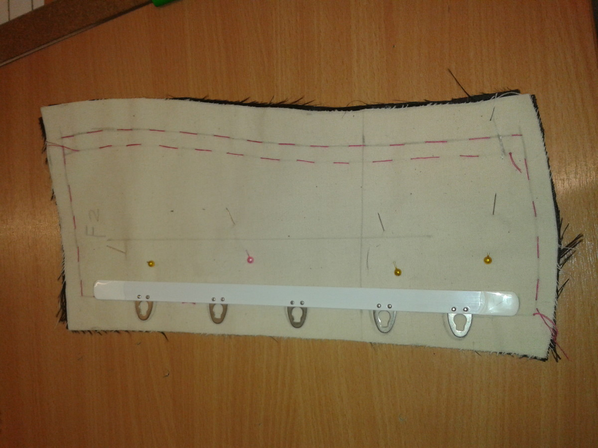 Hook side: place the busk carefully onto the flat side of the pattern piece, and draw around it