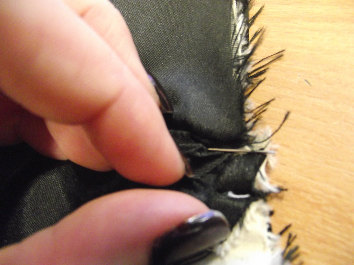 flatten the seams and pin lining in between to keep them flat