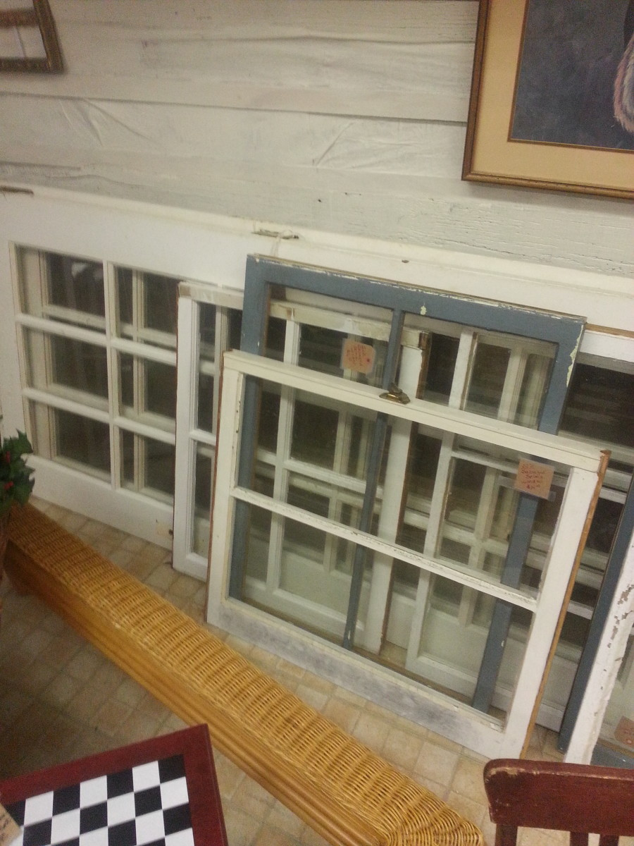 Finding old wood windows at a flea market to repurpose.