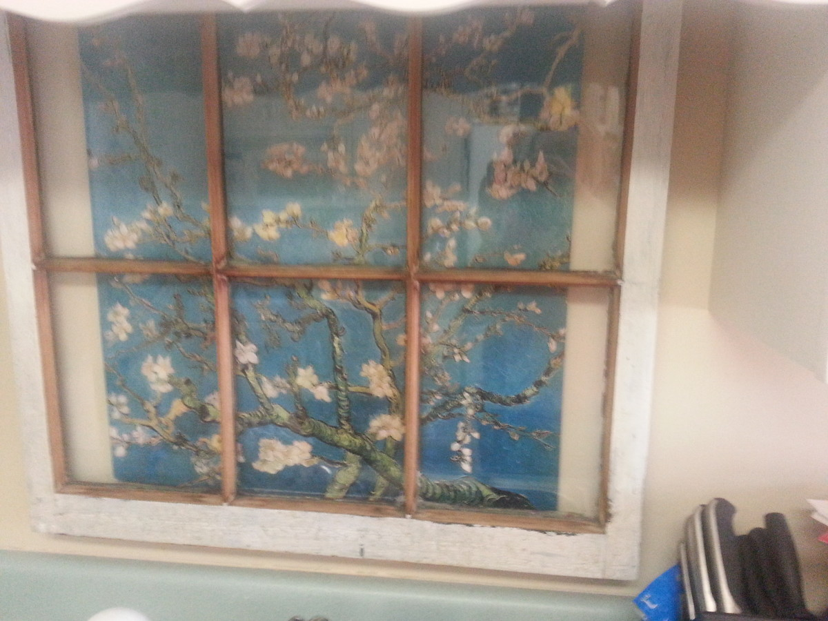 Old repurposed wood window hanging over my kitchen sink.