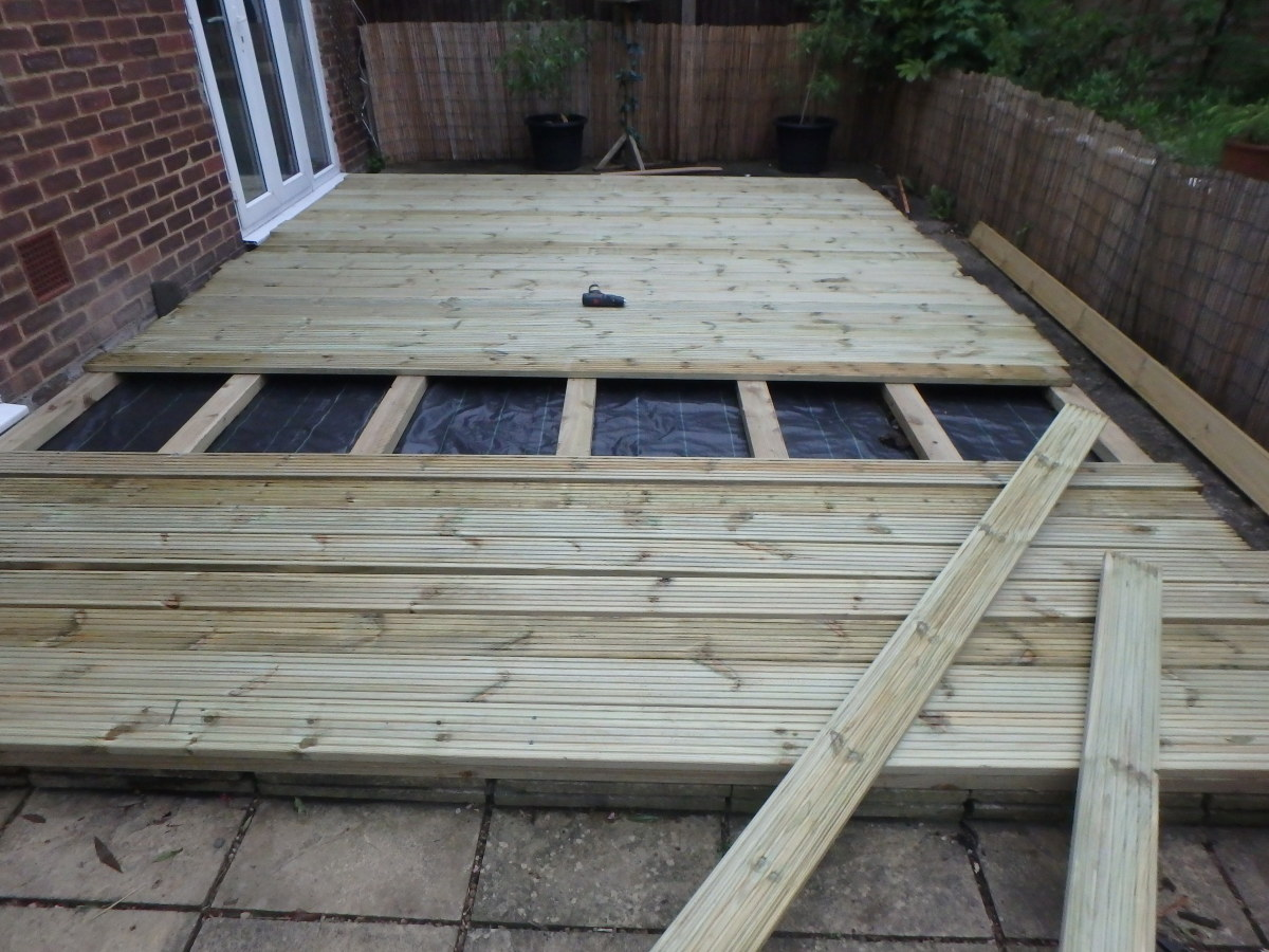 Screwing down the decking with an electric screwdriver